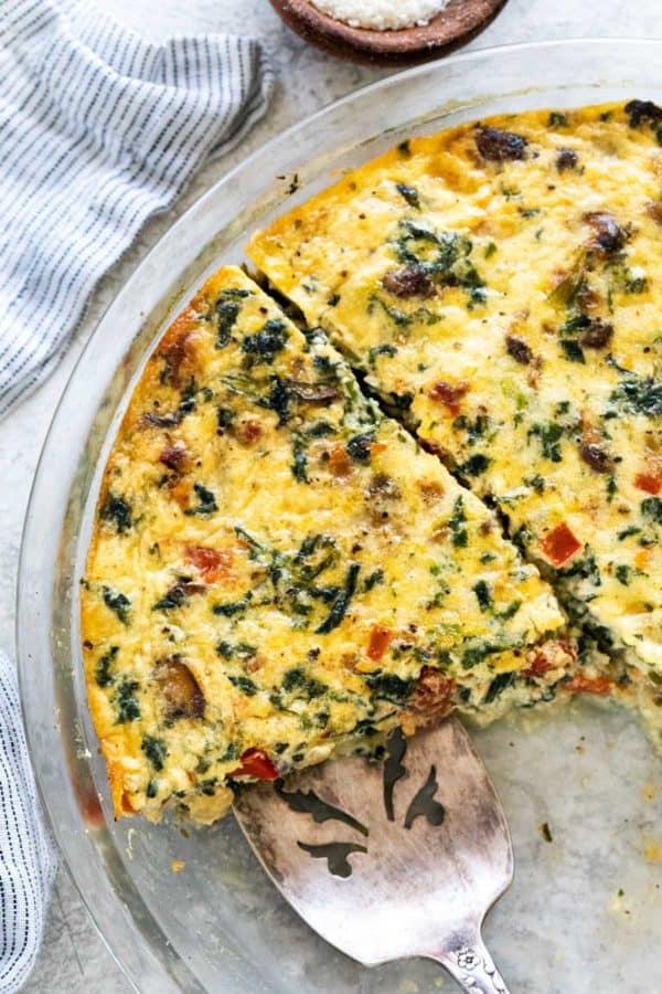 crustless spinach quiche in glass pie dish