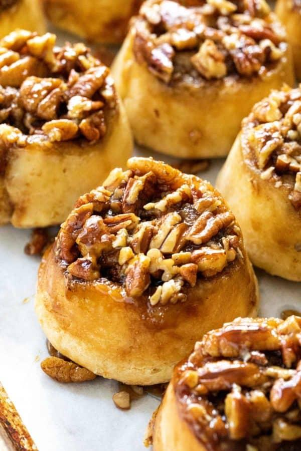 pecan sticky buns on a baking sheet