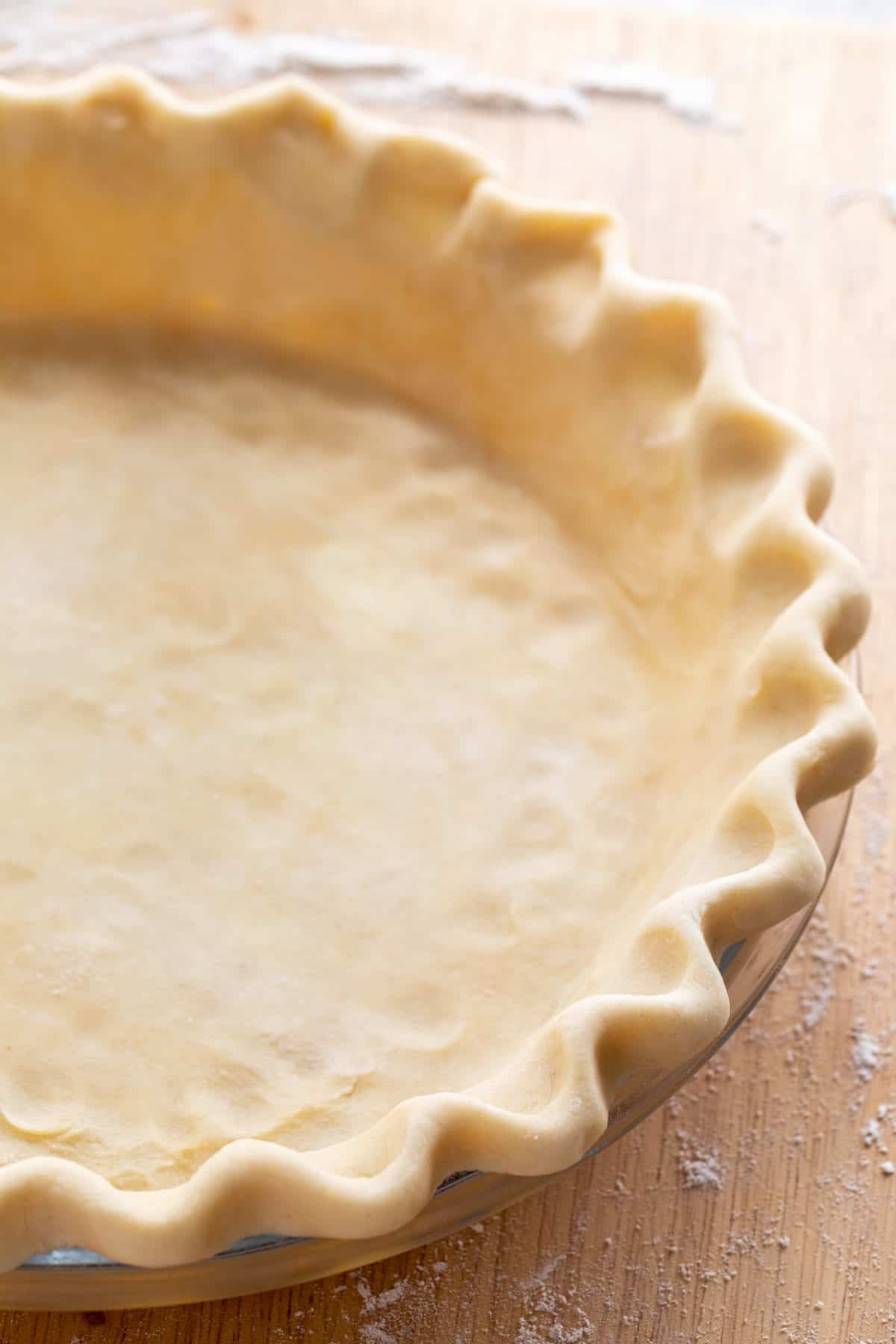 finished pie crust in a glass plate