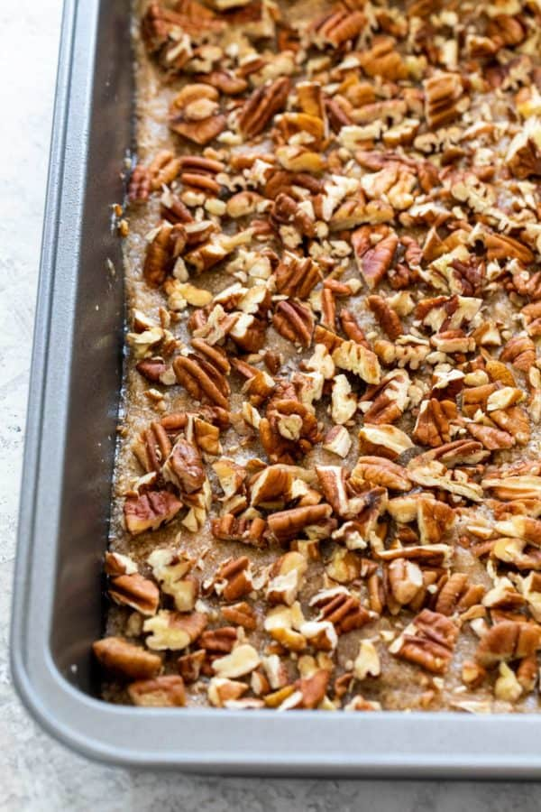 baking pan with sauce and pecans
