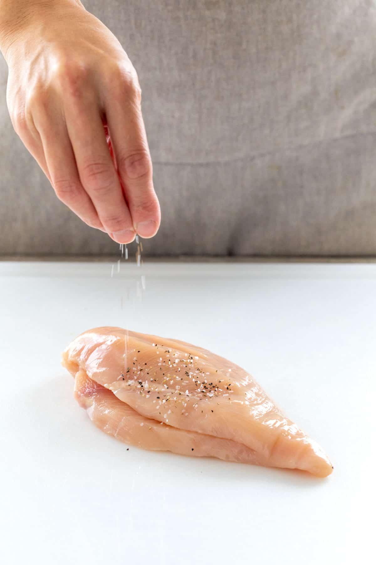 seasoning the chicken surface