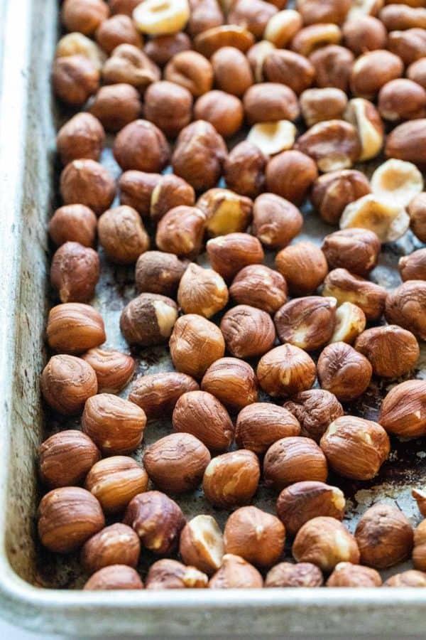 roasted hazelnuts on a baking sheet