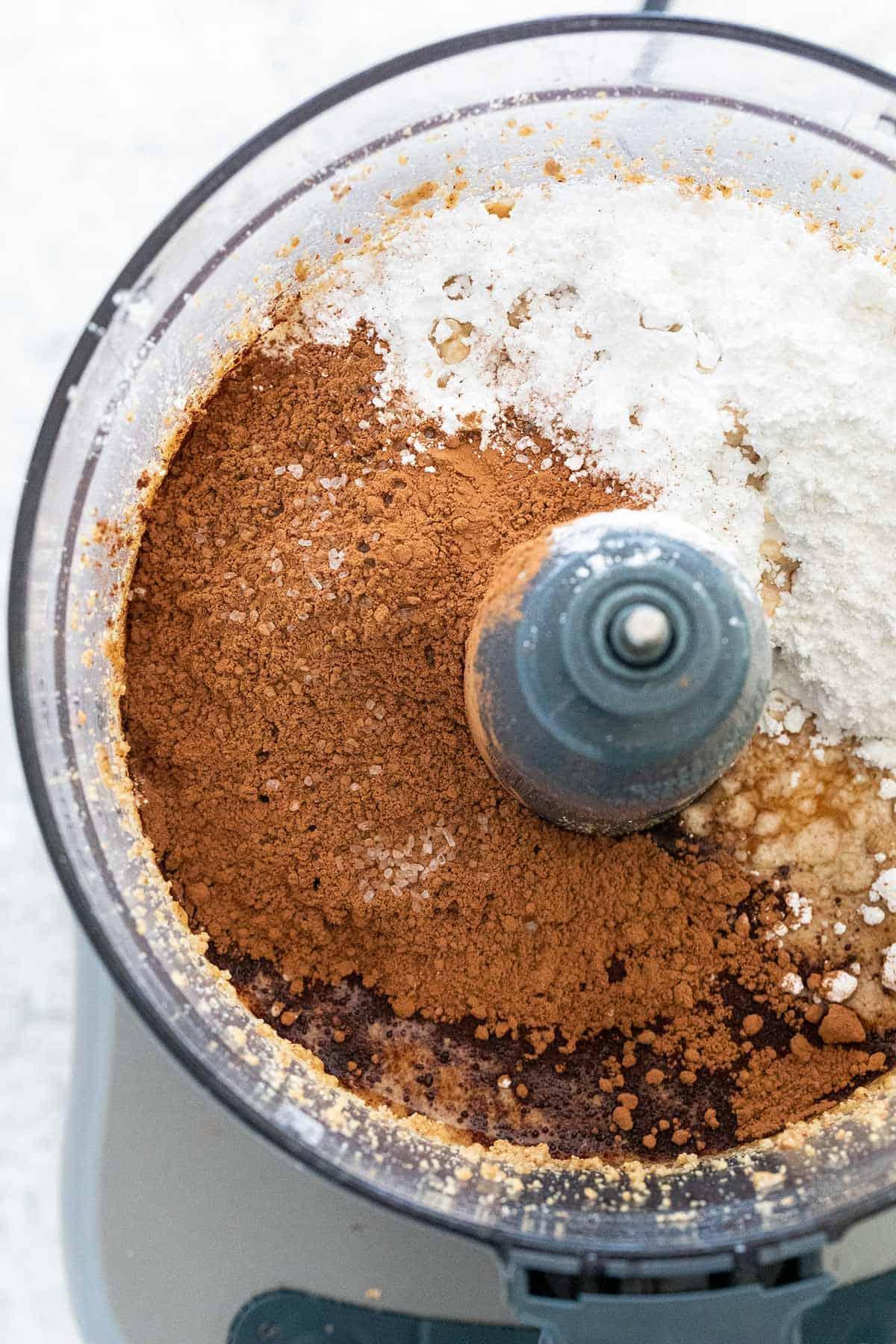 sugar and cocoa powder added to the processor