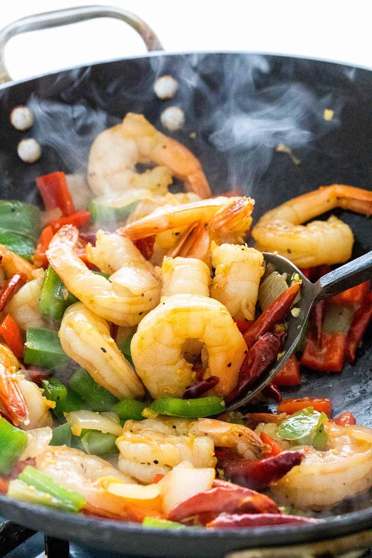 shrimp stir frying in a wok
