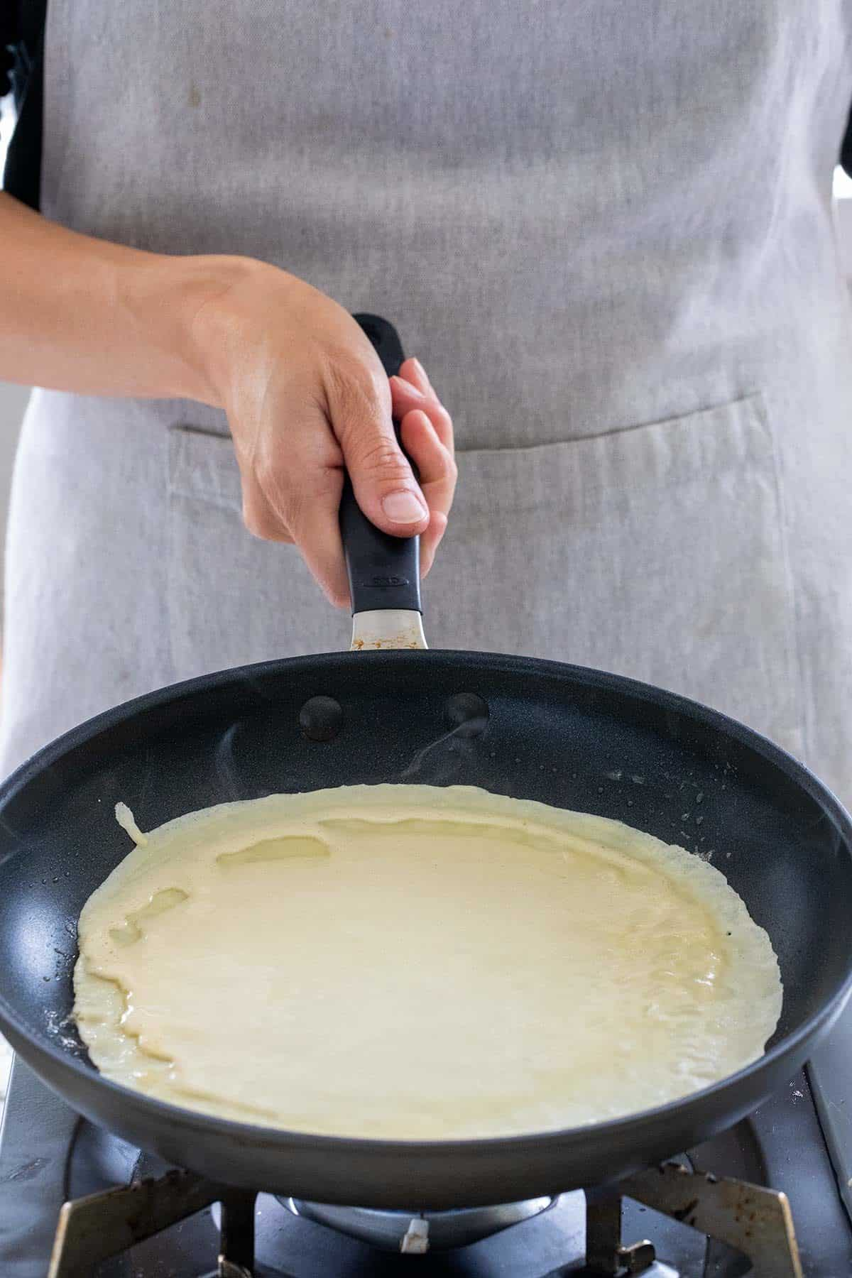 tilt the pan to spread the batter