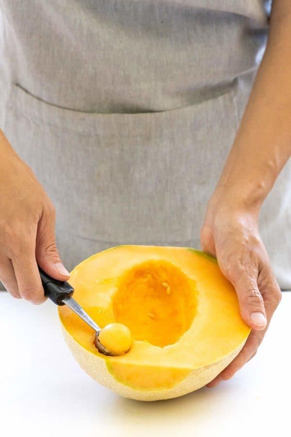 melon baller making cantaloupe spheres