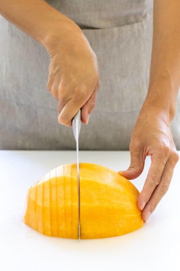 slicing a melon into thin pieces