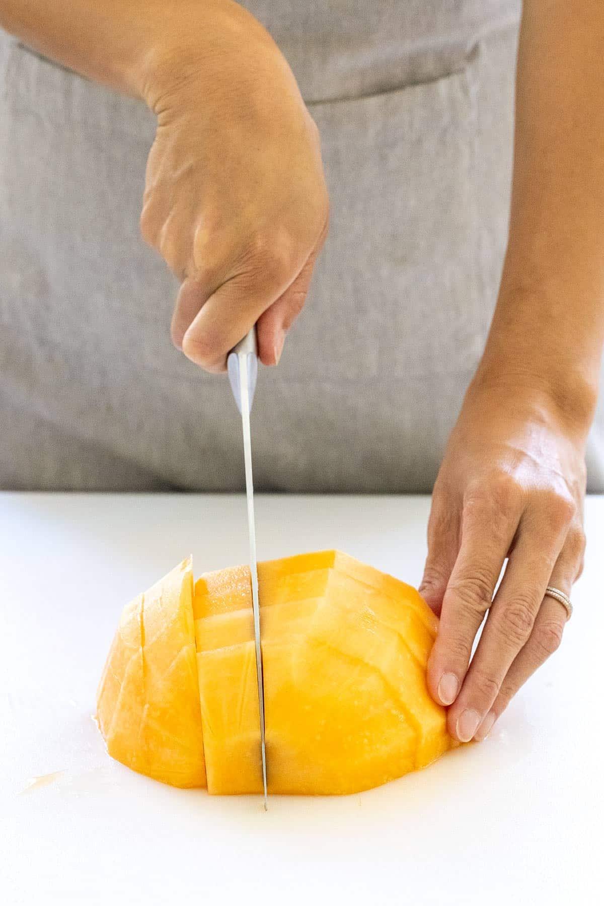 cutting a melon into cubes