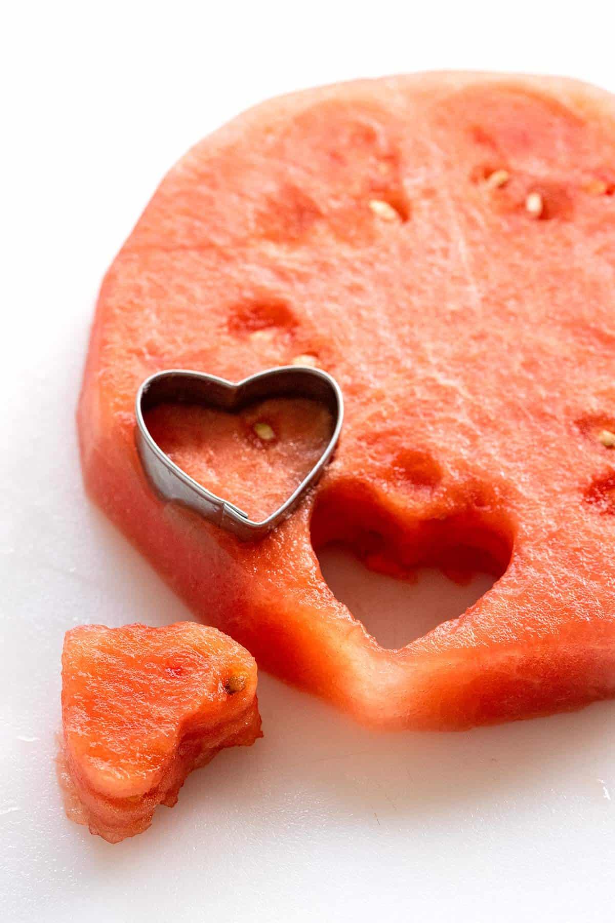 cut out watermelon heart shapes