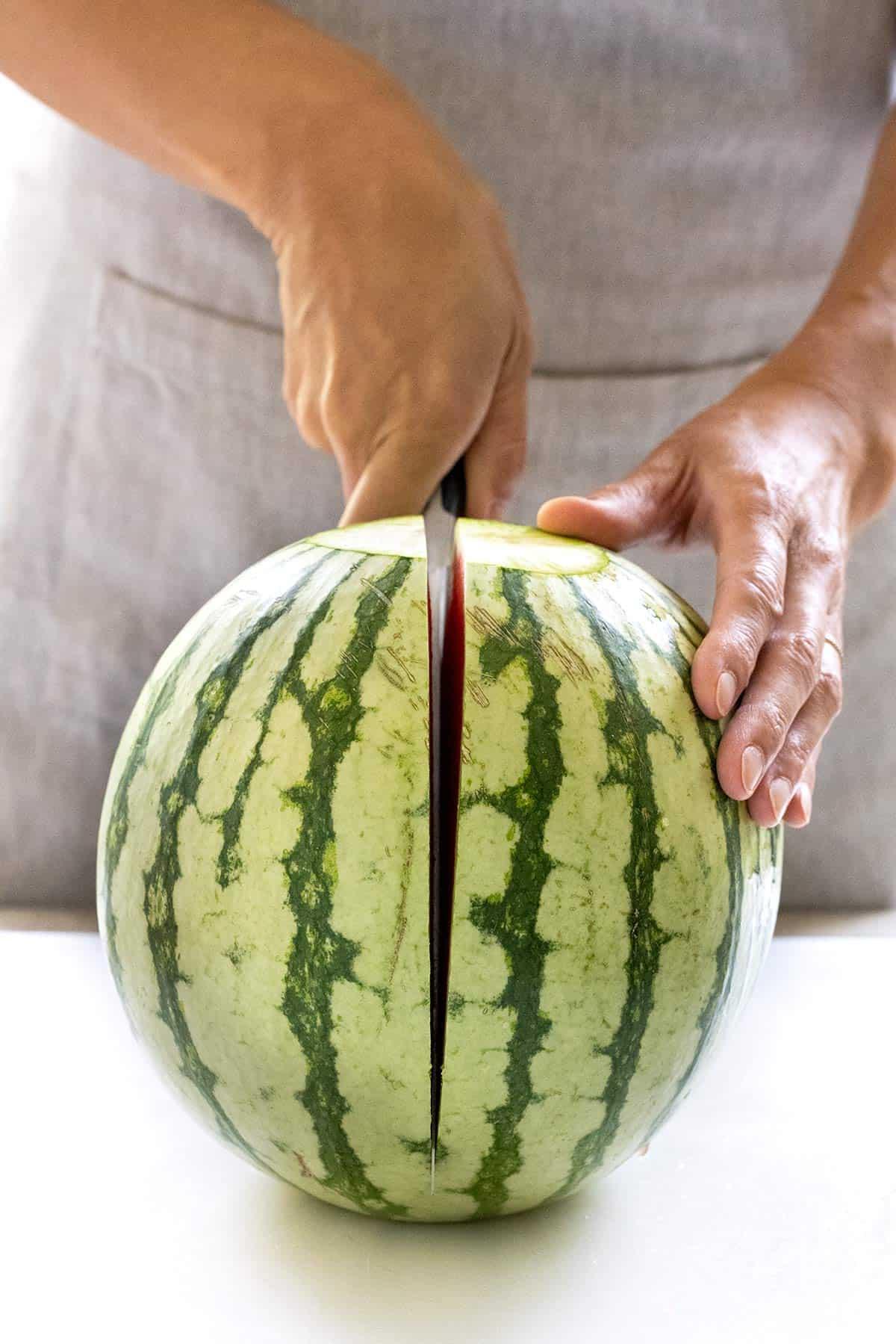 cut a watermelon into two halves