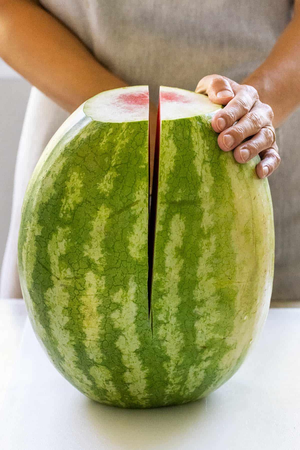 slicing a watermelon in half