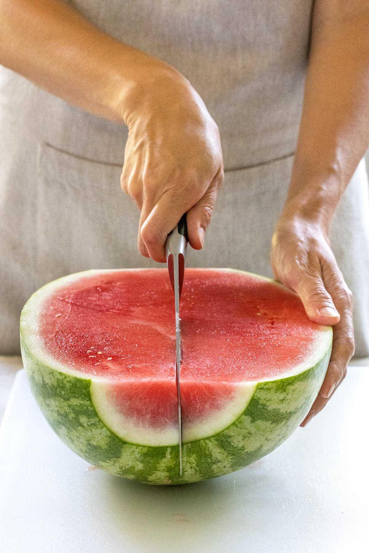 cutting a watermelon into quarters