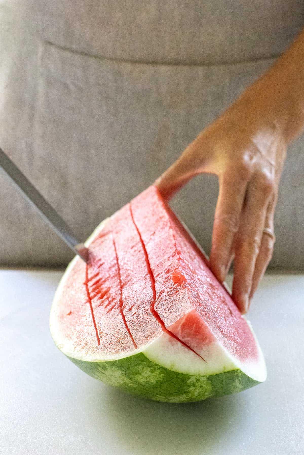cutting into watermelon horizontally