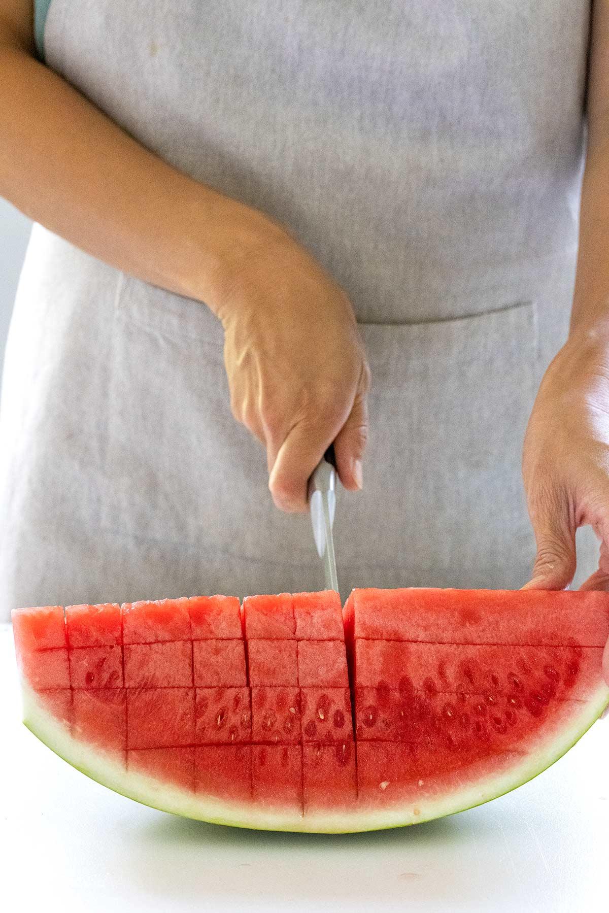 cutting watermelon into a crosshatch
