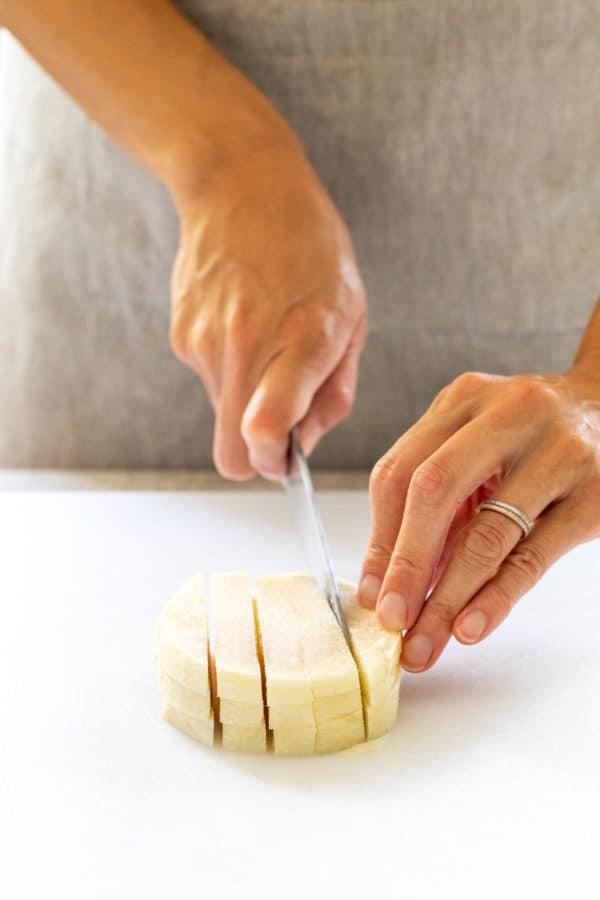 jicama being cut into long strips