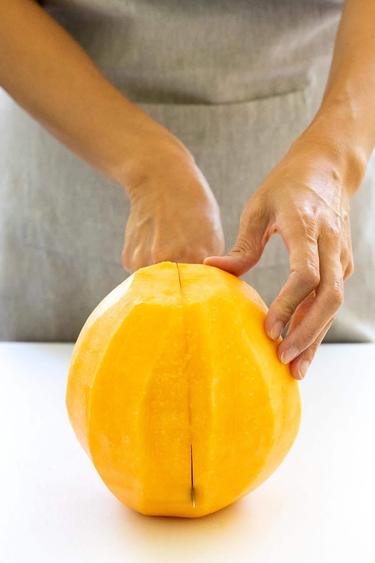 cutting a melon into halves