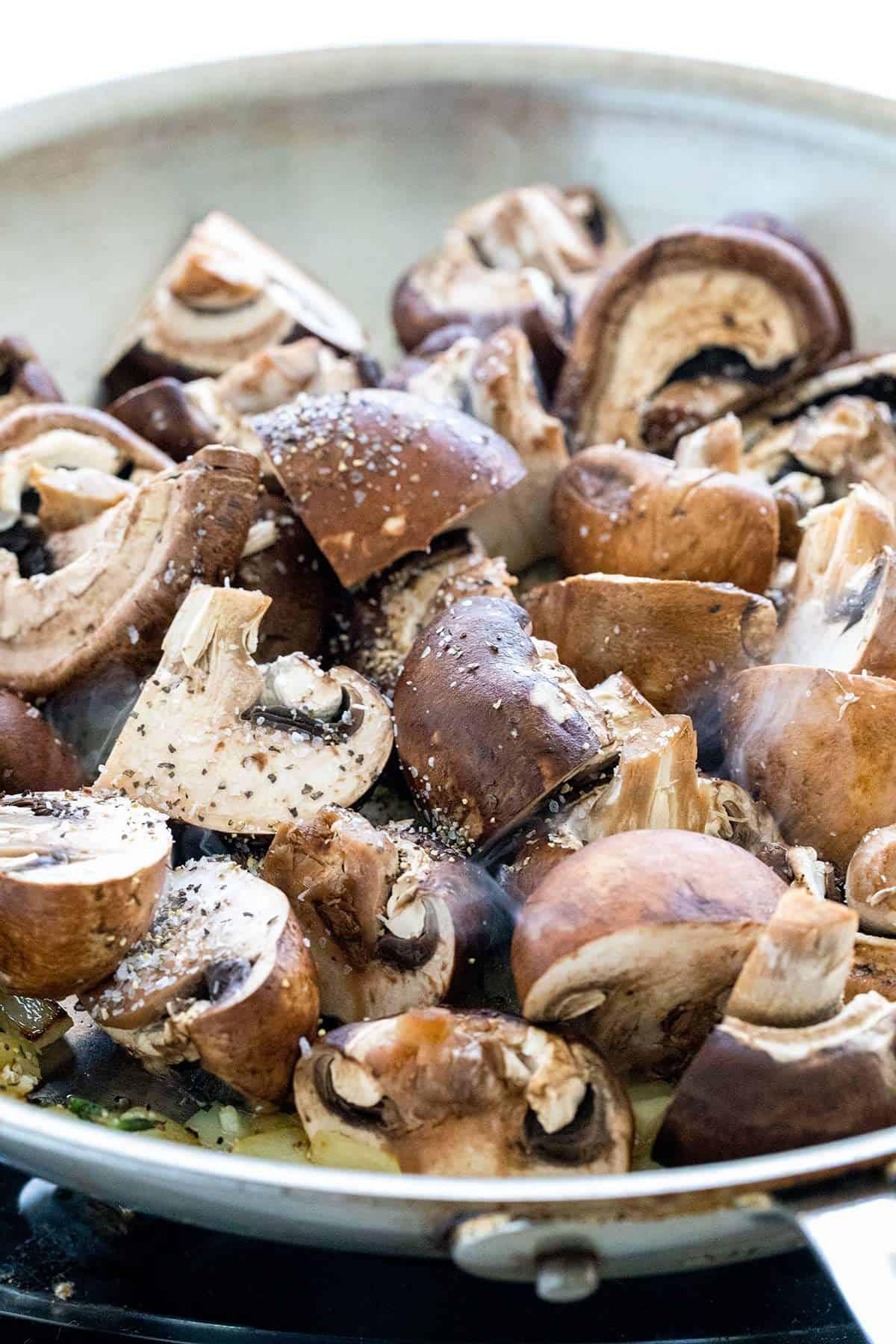 raw mushrooms in a pan