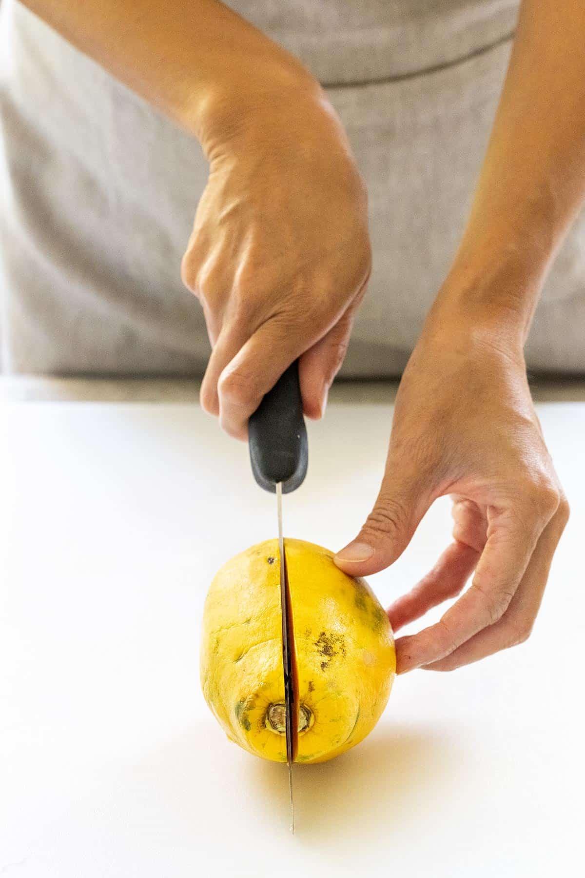 cutting a papaya in half