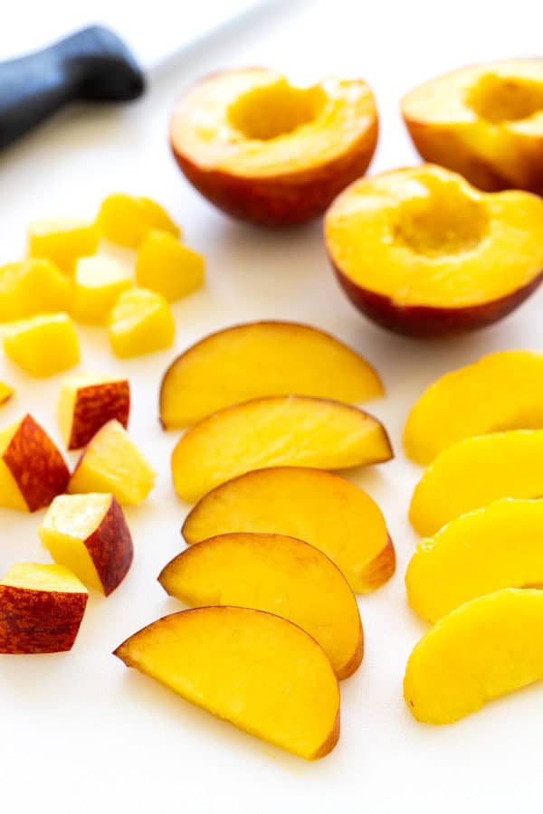 several different shapes of cut peaches