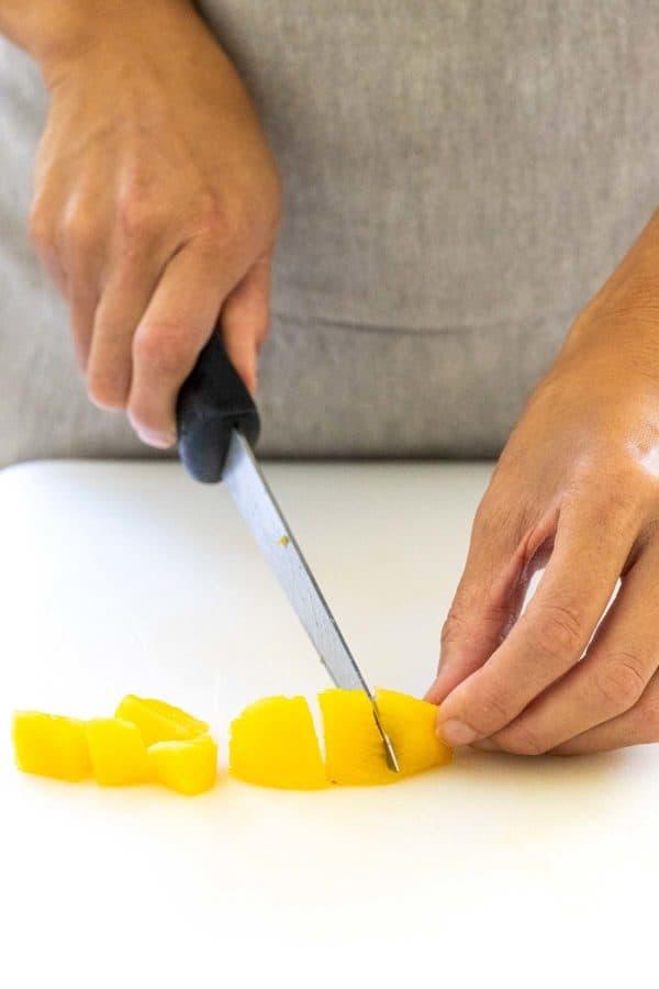 cutting peach cubes