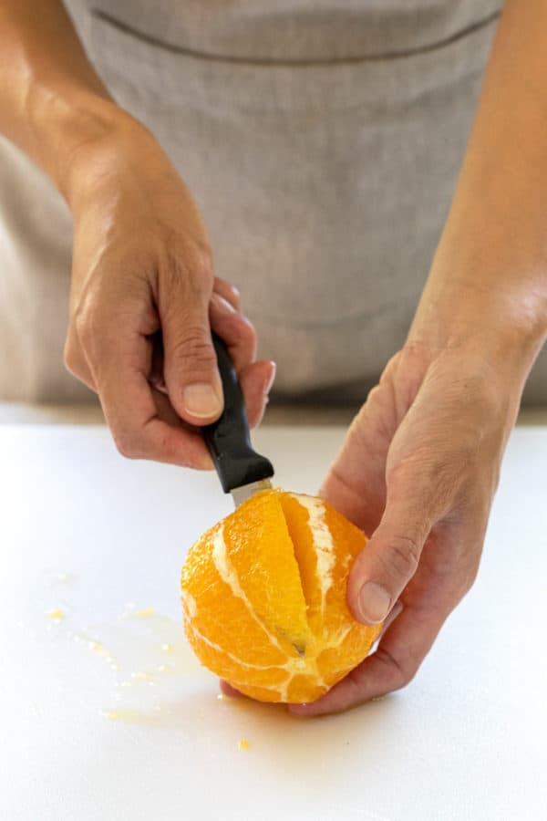 cutting out segment from an orange