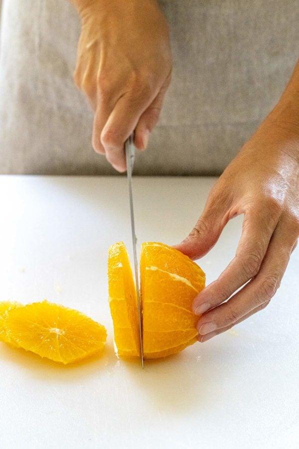 slicing an orange into wheel shapes