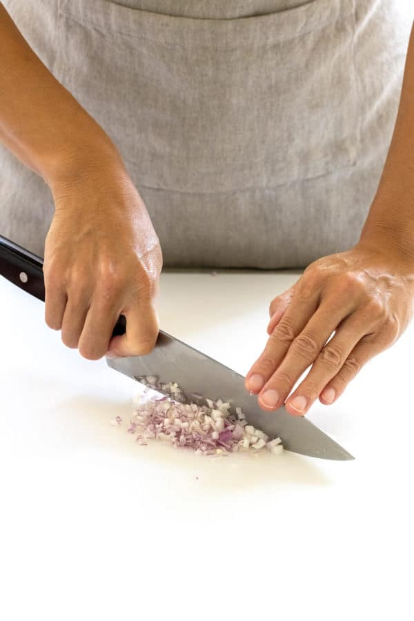 chefs knife mincing shallots