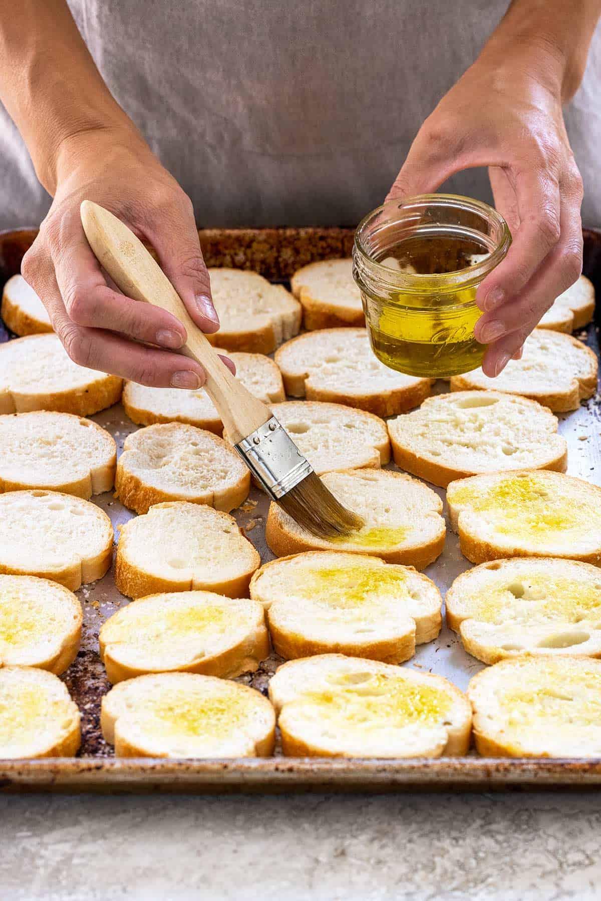 brushing oil on bread slices